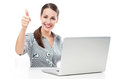 Woman with laptop showing thumbs up young over white background Royalty Free Stock Images