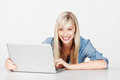 Woman with laptop smiling blond female holding a in a font view shot Stock Photos