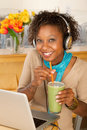 Woman With Laptop and Smoothie Royalty Free Stock Photography