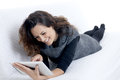 Woman with laptop on white sheet in her bed Royalty Free Stock Photo