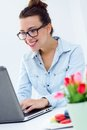 Woman with laptop working at home beautiful young Stock Images
