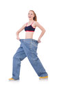 Woman with large jeans in dieting concept Royalty Free Stock Image
