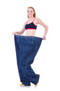 Woman with large jeans in dieting concept Royalty Free Stock Photo