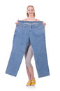 Woman with large jeans in dieting concept Royalty Free Stock Photos