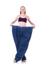 Woman with large jeans in dieting concept Stock Images