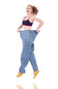 Woman with large jeans in dieting concept Royalty Free Stock Images