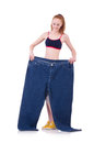 Woman with large jeans in dieting concept Stock Photos