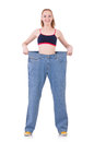 Woman with large jeans in dieting concept Stock Photography