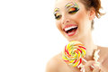 Woman laughing with candy and beautiful make-up young attractive Royalty Free Stock Photography