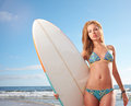 Woman laughing fun with running with surfer bodyboard beach Stock Photography