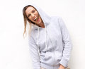 Woman laughing with hood sweatshirt on white background portrait of a Stock Photos