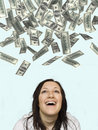 Woman laughing at money rain Stock Photography