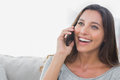Woman laughing while she is on the phone Royalty Free Stock Photo