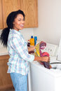 Woman laundry african american doing Royalty Free Stock Image