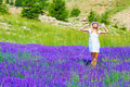 Woman in lavender field attractive with closed eyes enjoying bright warm sun light spending time on beautiful fresh purple summer Stock Photos