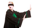 Woman lawyer attorney in polish black green gown with blindfold blind justice wearing classic poland covering eyes isolated on Royalty Free Stock Images