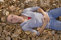 Woman laying on back in leaves Royalty Free Stock Image