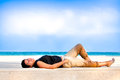Woman laying on beach. Stock Photo