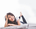 Woman laying on the bed thinking resting her body looking up to copyspace Stock Photography