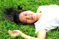 Woman laying down in grass young lying Royalty Free Stock Image