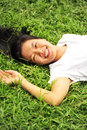 Woman laying down in grass young lying Stock Photo