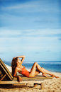 Woman laying on a sunbed beautiful beach Stock Images
