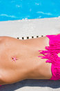 Woman laying by the swimming pool with a starfish on her belly Royalty Free Stock Photo