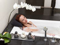 Woman lays in soapsuds in bathing full water Royalty Free Stock Photo