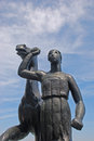 Woman leading horse statue in basel with blue sky Royalty Free Stock Image