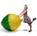 Woman leaning on a lemon lime beautiful young Royalty Free Stock Image