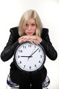 Woman leaning on wall clock Stock Image