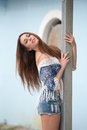 Woman leaning on wooden pillar Royalty Free Stock Photo
