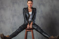 Woman in leather clothes and boots stretching her legs Royalty Free Stock Photo