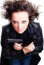 Woman in leather wear holding guns Royalty Free Stock Photo