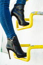 Woman legs in denim pants heels shoes outdoor Royalty Free Stock Photo