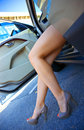 Woman legs exit the car Royalty Free Stock Photo
