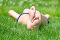 Woman legs on green grass Royalty Free Stock Photo