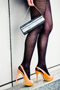 Woman legs in high heel shoes and striped stockings Stock Images