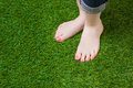 Woman legs injeans standing  on green grass Royalty Free Stock Photo