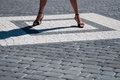 Woman legs in quadrant stone the place Royalty Free Stock Photo