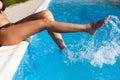 Woman legs splashing in the water Stock Photos