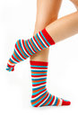 Woman legs in strip sock Royalty Free Stock Images