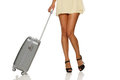 Woman legs with a suitcase Royalty Free Stock Photo