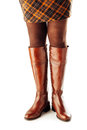 Woman legs wearing brown leather high boots