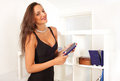 Woman leisure lifestyle lady choosing a book with smile Royalty Free Stock Photography
