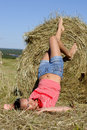 Woman lie near haystack Royalty Free Stock Photo