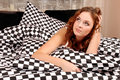 Woman lies in bed Royalty Free Stock Photos