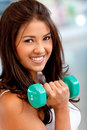 Woman lifting free weights Royalty Free Stock Photo