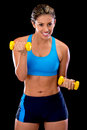 Woman lifting free-weights Royalty Free Stock Photo