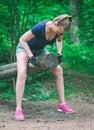 Woman lifting log. Royalty Free Stock Photo